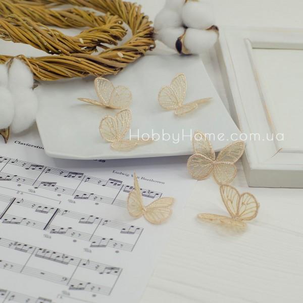 Метелики ажурні , золоті